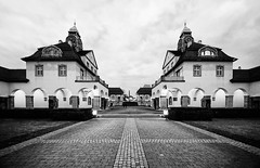 Nostalgic (Philipp Klinger Photography) Tags: sky bw white black tower art clock architecture night clouds germany point deutschland gold blackwhite nikon europa europe long exposure hessen bad sigma symmetry symmetrical sw nouveau vanishing vignetting philipp weiss 1224mm archs schwarz hesse nauheim klinger badehaus sprudelhof d700 dcdead