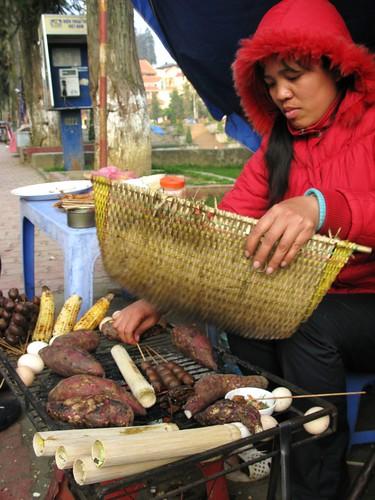 Fanning the grill coals, Sapa, Vietnam