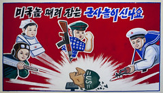 "Propaganda Poster in Chongsan-ri Farm school : ""It is exciting to play soldiers beating and seizing the Americans"" North Korea (Eric Lafforgue) Tags: pictures school usa army photo kid war asia kill child propaganda satellite picture korea kimjongil rocket asie launch coree pupil northkorea pyongyang dprk propagande coreadelnorte 2633 kimilsung nordkorea    coredunord coreadelnord  northcorea coreedunord  insidenorthkorea  rpdc  coriadonorte  kimjongun coreiadonorte  longrangerocket longrangeballisticmissiletest"