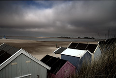 Les Vacances Anglaises (Nicolas Valentin) Tags: uk trees light sea england sun kite bird beach water clouds coast boat seaside sand woods scenery dunes dune norfolk wells huts southeast raining beachhuts eastanglia wellsnextthesea northnorfolk