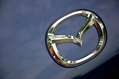 M or bird? (GmanViz) Tags: color detail car emblem nikon automobile chrome badge mazda 2008 miata mx5 d90 stormyblue gmanviz