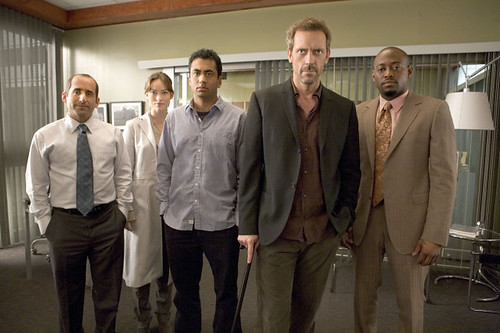 The cantankerous, cane-wielding Dr. House and his quirky, irreverent (note Kal Pens untucked shirt!) team of crack doctors