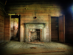 Presence (evanleavitt) Tags: county wood house texture abandoned home rural ga georgia fireplace warm doors open darkness decay interior details atmosphere olympus spooky hearth weathered presence tones laurens hdr crumbling e510 photomatix sumterville