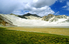 karakoram highway - sand lake (Csbr) Tags: 2005 china travel blue summer sky mountain lake green clouds landscape bush sand highway dune border salt august xinjiang silkroad karakoram centralasia canonixus400 pamir tashkurgan highplateau gettyscreening