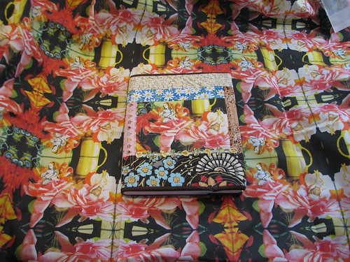 finished journal on top of fabric I made with Spoonflower
