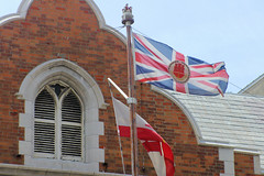 Gibraltar Flag Ove The Gov's House (cwgoodroe) Tags: ocean uk england costa sun lighthouse london castle sol beach beer del square airplane colorful europe wind gib military mosque bobby zane pint gibraltar runway policestation fishandchips territory instalation gibralter moneky fedra europapoint airtower angryfriar 3sheets zanelampry corgovesselsummer vesselcollision