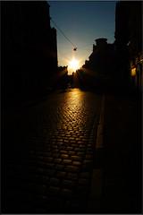 Poznan Sun.... (Womble67) Tags: street sky sun reflection silhouette shadows streetlamp poland panasonic cobbles poznan staremiasto kerbstones wielkopolska 5photosaday lx3 stoecznemiastopozna