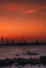 They call it a city ... it's my city! (mr.alsultan) Tags: city red sea orange clouds sunrise canon buildings fire eos rebel 50mm rocks kuwait 18 xsi q8 freezone 450d alsultan  mohammedalsultan