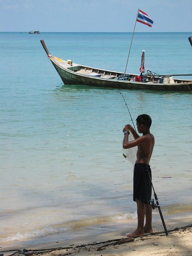 Boy fishing on Rawai Beach, Phuket