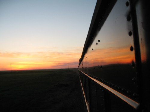 Train Chartering - view from Royal Canadian Pacific of an Albertan sunset