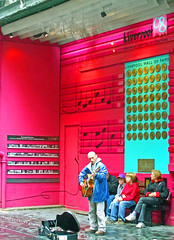 Busker, Mathew Street, Liverpool (Lydie's) Tags: uk pink england urban music liverpool guitar buskers guitarist mathewstreet merseyside walloffame liverpool08