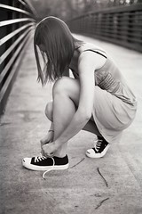 Converse. (The Vision Beautiful) Tags: bridge blackandwhite bw girl hair shoes dress tennis teen converse brunette tying unedited carolinetaylor kodakprofessional400blackandwhite35mmfilm