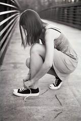 Converse. (The Vision Beautiful) Tags: bridge blackandwhite bw girl hair shoes dress tennis teen converse brunette tying unedited carolinetaylor kodakprofessional400blackandwhite35mmfilm