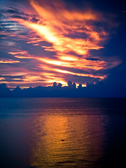 Dolphin Sunset (J.K. Hering Photography) Tags: ocean sunset sun reflection water clouds colorful dolphin marcoisland