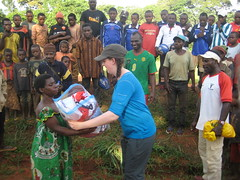 Fliss presenting gifts to the Baka community