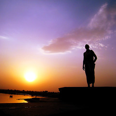 Time for peace (JannaPham) Tags: travel sunset sky sun india reflection water silhouette sunrise canon river golden boat peace purple monk krishna ruslan rishikesh ixy 500x500 project365 77365 910is jannapham nguyenquocthang