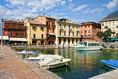 Malcesine Harbour, Lake Garda, Italy (sminky_pinky100 (In and Out)) Tags: travel italy tourism water architecture reflections landscape boats europe pretty harbour scenic tourists colourful picturesque malcesine cafes lakegarda personalbest 5photosaday bej omot eyejewel betterthangood travelsofhomerodyssey