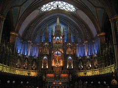 The illuminated interior of the Basilica Notre Dame is breathtaking.