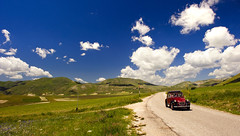 Road to Castelluccio (Massimo Feliziani) Tags: road blue vacation sky holiday italian strada italia citroen citroën 2cv umbria vacanze norcia castelluccio aventure landcsape duecavalli d700