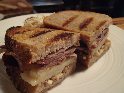 smoked duck breast sandwich with sheeps milk cheddar and apple walnut paste