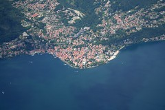 Como Lake - Menaggio (_ Night Flier _) Tags: above city travel blue sky italy panorama lake como green rooftop nature water airplane landscape town flying high view earth top aviation aerial h2o fromabove coastline lombardia cessna skyview lagodicomo lombardy birdeye aeronautic menaggio