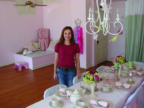 Business owner Deinna Cervera stands inside Once Upon a Time, 3145 S. Howell Ave., which hosts imaginative parties for young girls. ~photo Michael Timm