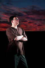 Man Infront of Sunset (Billy Wilson Photography) Tags: light sunset sky ontario canada man silhouette shirt clouds digital canon person eos rebel pants silhouettes atmosphere human xs soo vivitar youngman strobe saultstemarie northernontario algoma speedlite armscrossed 430ex strobist billywilsonphotography