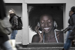 Listening to the sound of the street (Gilad Benari) Tags: street city people urban art amsterdam wall walking print poster funny humor ad sound bigcity gilad bilboard crowdedstreet   humourus giladbenari  homur   homourus