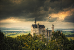 Neuschwanstein - HDR (manganite) Tags: sky mountains color green castle topf25 colors weather architecture clouds digital photoshop buildings germany dark de landscape geotagged bayern bavaria iso200 interestingness topf50 nikon colorful europe mood cloudy tl dramatic vivid historic explore highsaturation d200 f80 nikkor dslr neuschwanstein hdr highdynamicrange hdri hohenschwangau lightroom schwangau photomatix nikond200 tonemapped interestingness39 i500 18200mmf3556 4exp manganite colorefexpro 1250sec date:year=2008 date:month=september vosplusbellesphotos date:day=19 geo:lat=47554953 1250secatf80 format:ratio=32 format:orientation=landscape geo:lon=10749328