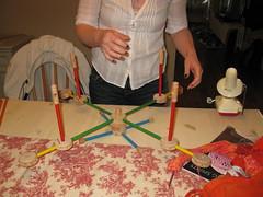 Unraveling Sets Up the Swift (Stevie Rocco) Tags: swift unraveling tinkertoys yarnswift yarnwinding knitpistols tinkertoyswift