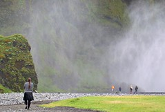 Approaching Skogarfoss (ystenes) Tags: woman mist green waterfall iceland skirt 1001nights foss magiccity skogar platinumheartaward flickrestrellas
