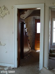 Abandoned Victorian House, Interior View Through West Living Room Door - 4/10/09  UPDATE:  DEMOLISHED (randomroadside) Tags: old abandoned ghost creepy peelingpaint ghostly deserted deteriorated victorianhouse vacanthouse abandonedbarn dilapedated hautedhouse dilapedatedhouse
