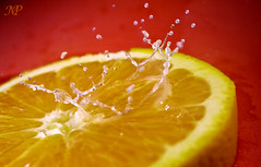 Splash on Orange ! (|| Msh3L Alomran ||) Tags: red orange ex water fruit canon drops photographer background drop 1855mm splash speedlite         meshal alomran  1000d  430ii