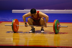 Concentration (julie.froo) Tags: sports singapore potd weightlifting sportsphotography gewichtheben joj olympicsport sollevamentopesi haltrophilie youtholympicgames singapore2010 syogoc toapayohsportshall singapour2010 jeuxolympiquesdelajeunesse validationexercise exercicedevalidation singaporeopenchampionships menover77kg