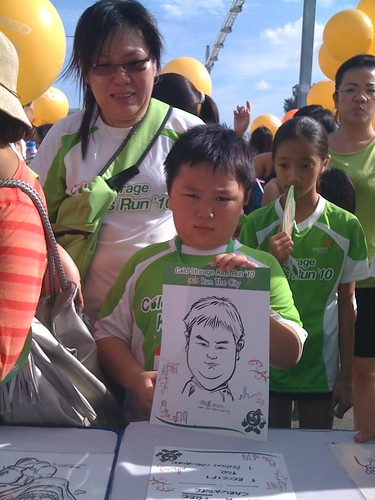 caricature live sketching for Cold Storage Kids Run 2010 - 3