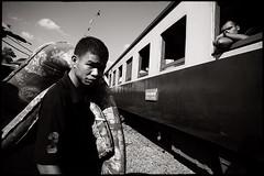 a man with a mattress (fly) Tags: asia thailand bangkok man train railway simonkolton fly