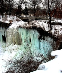 Frozen Falls of Minihaha, Minneapolis, Minnesota (moonjazz) Tags: park bridge blue winter light urban white snow cold ice nature beauty minnesota creek season landscape frozen amazing still midwest quiet walk north minneapolis best freeze wilderness dakota refuge minihaha watefall 5photosaday anawesomeshot flickrlovers