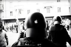 Apple Totalitarism (Geneva) (tchebotarev) Tags: car geneva swiss rifle police gas masks tired protests teargas globalism antiglobalismgeneveswitzerlandtravelgasmaskspoliceprotestriflesriotteargasriot policementantiglobalismgeneveswitzerlandtravelgasmaskspoliceprotestriflesriotteargas