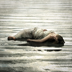 grains of water (brookeshaden) Tags: selfportrait reflection beach wet water death sand desert sundown sandy hills bones sheet desaturated ripples heavy highlight drown contorted wetsand nikond80
