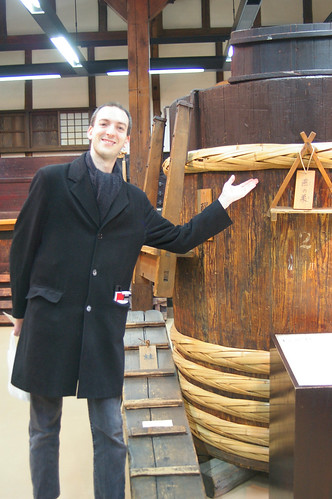 Loren with Sake fermetation barrel at Gekkeikan
