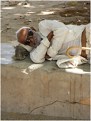 i can see you, dhaneti kutch (nevil zaveri (thank you for 10million+ views :)) Tags: old sleeping portrait people india man sunglasses walking photography