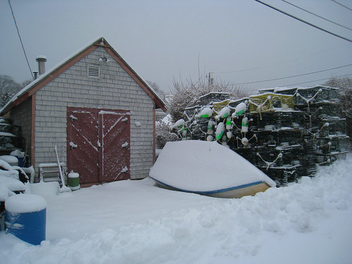 boat and lobster traps in snow