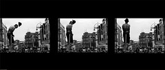 Son Got His Hat On. (Air Adam) Tags: blackandwhite man hat chains triptych crowd leeds streetperformer ladder trick flick chained escapologist briggate