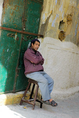 Grumpy Moroccan (cwgoodroe) Tags: ocean africa street old city sea summer people sun fish bus colors metal ferry plane children cafe sand ancient colorful doors artistic pentax vibrant muslim poor streetlife mosque arabic panasonic doorway morocco arab friendly moors conservative script casbah vegtable merchants continent merchant christians tangier monger moroccan tanger kasbah cleric sadfaces metaldoors fishmerchant casba casbha dailylifeportrait
