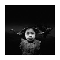 Another Day On Earth (Fusty Box) Tags: blackandwhite girl face dress painted young squareformat golgotha 500x500 ramshorns thankstothe|g| foryourkindinterruption