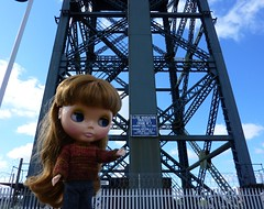 It's my turn to pose by the giant crane!