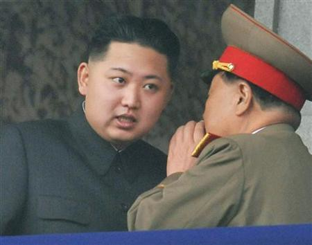 Democratic People's Republic of Korea (DPRK) official Kim Jong-un consults during the commemorations in honor of the 65th anniversary of the formation of the ruling Worker's Party of North Korea. The parade was held on Oct. 10, 2010 in Pyongyang. by Pan-African News Wire File Photos