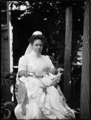 Portrait of a nurse in white, holding twin babies (Powerhouse Museum Collection) Tags: bw baby outdoors twins veil lace foliage cap newborn nurse asleep powerhousemuseum starch xmlns:dc=httppurlorgdcelements11 dc:identifier=httpwwwpowerhousemuseumcomcollectiondatabaseirn386433