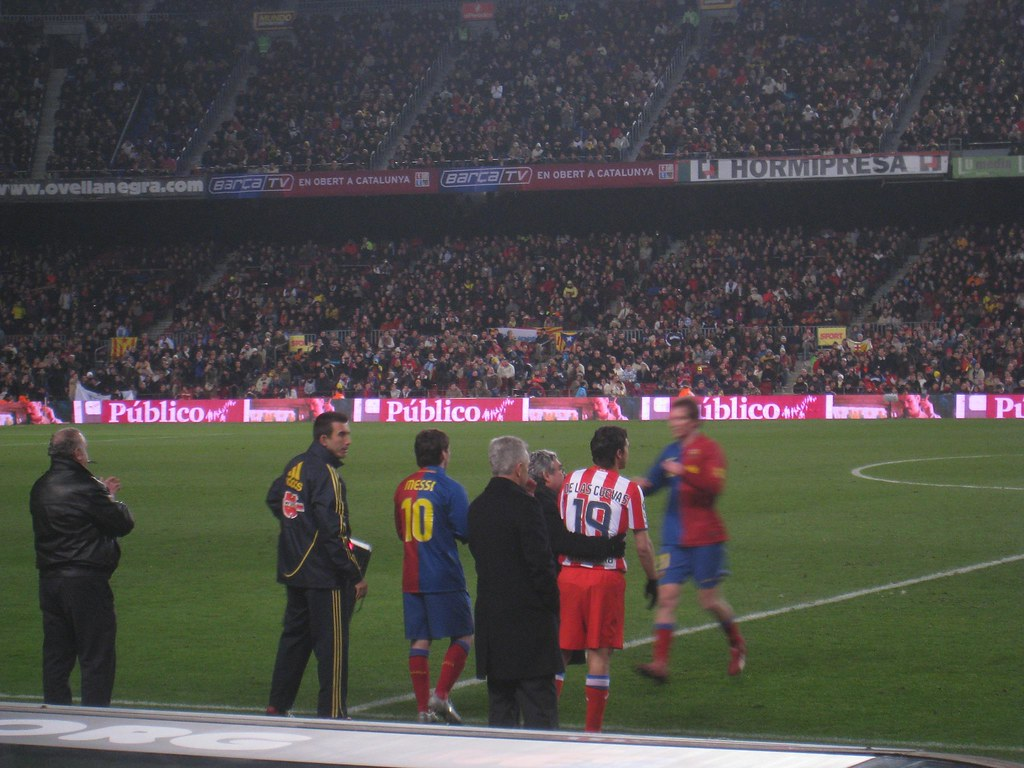 Lionel Messi prepares to enter the match for FC Barcelona.