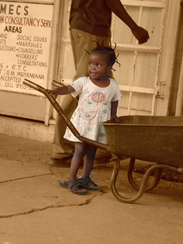Girl with wheelbarrow - Zambia